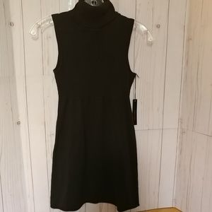 BCBG Maxazria is black knit tunic-S